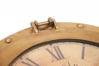 Настенные часы иллюминатор