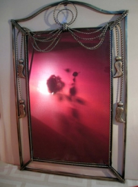 Зеркало в металлической раме